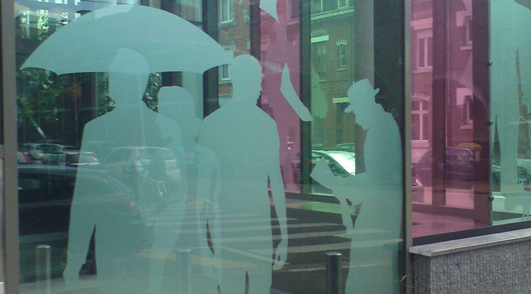 Marquage adhésif film sablé sur vitrine